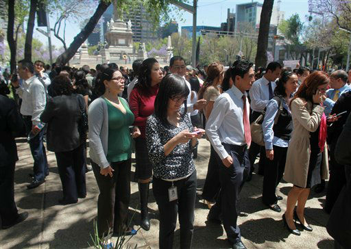 "<div class=""meta image-caption""><div class=""origin-logo origin-image ""><span></span></div><span class=""caption-text"">Workers and residents gather at the Angel de la Independencia square after evacuating buildings during a earthquake felt in Mexico City Tuesday March 20, 2012.  A strong, long earthquake with epicenter in Guerrero state shook central southern Mexico on Tuesday, swaying buildings in Mexico City and sending frightened workers and residents into the streets. (AP Photo/Dario Lopez-Mills) (AP Photo/ Dario Lopez-Mills)</span></div>"