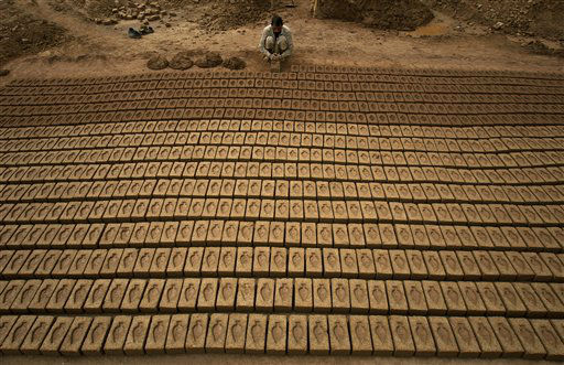 A Pakistani worker prepares bricks at a bricks factory on the outskirts of Islamabad, Pakistan on Tuesday, March 20, 2012. &#40;AP Photo&#47;Anjum Naveed&#41; <span class=meta>(AP Photo&#47; Anjum Naveed)</span>
