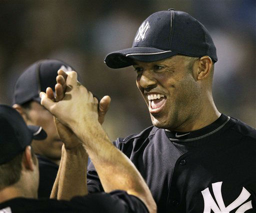 New York Yankees&#39; Mariano Rivera is congratulated as he returns to the dugout after pitching a scoreless fourth inning during a spring training baseball game against the Pittsburgh Pirates at Steinbrenner Field in Tampa, Fla., Tuesday, March 20, 2012.  &#40;AP Photo&#47;Kathy Willens&#41; <span class=meta>(AP Photo&#47; Kathy Willens)</span>