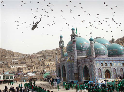 An Afghan military helicopter flies over the crowd gathered for a celebration of the Persian New Year Nowruz at the Kart-e-Sakhi shrine in Kabul, Afghanistan, Tuesday, March 20, 2012. Nowruz, the Farsi-language word for &#34;new year,&#34; is an ancient Persian festival, celebrated on the first day of spring in countries including Afghanistan and Iran. &#40;AP Photo&#47;Musadeq Sadeq&#41; <span class=meta>(AP Photo&#47; Musadeq Sadeq)</span>