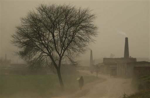 "<div class=""meta ""><span class=""caption-text "">A Pakistani villager walks during a dust storm in the suburbs of Islamabad, Pakistan, on Tuesday, March 20, 2012.  A massive dust storm engulfs various parts of Pakistan restricting the visibility and disrupting domestic and international flights in the country's southern region. (AP Photo/B.K. Bangash) (AP Photo/ B.K. Bangash)</span></div>"