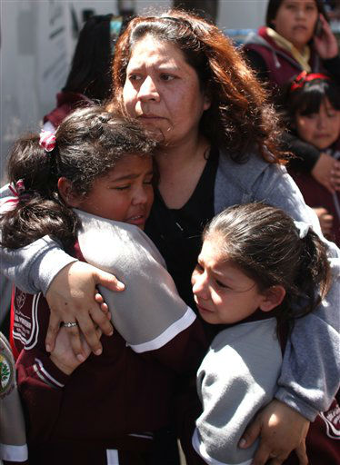 "<div class=""meta ""><span class=""caption-text "">A woman comforts her children outside a school at the Roma neighborhood after a earthquake felt in Mexico City, Tuesday March 20, 2012.  A strong, long earthquake with epicenter in Guerrero state shook central southern Mexico on Tuesday, swaying buildings in Mexico City and sending frightened workers and residents into the streets. (AP Photo/Alexandre Meneghini) (AP Photo/ Alexandre Meneghini)</span></div>"