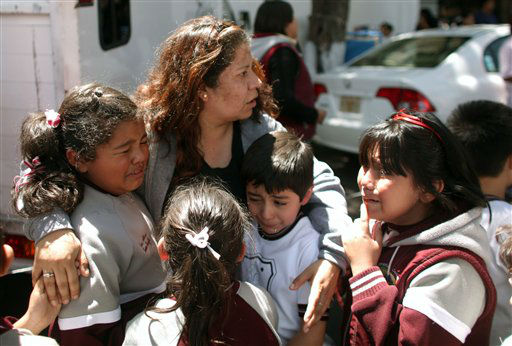 "<div class=""meta ""><span class=""caption-text "">A woman comforts her crying children outside a school in the Roma neighborhood after a earthquake was felt in Mexico City, Tuesday March 20, 2012.  A strong, long earthquake with epicenter in Guerrero state shook central southern Mexico on Tuesday, swaying buildings in Mexico City and sending frightened workers and residents into the streets. (AP Photo/Alexandre Meneghini) (AP Photo/ Alexandre Meneghini)</span></div>"