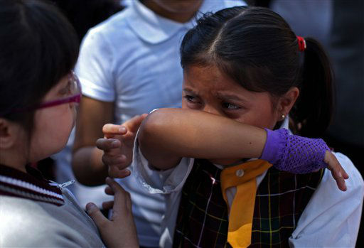 "<div class=""meta image-caption""><div class=""origin-logo origin-image ""><span></span></div><span class=""caption-text"">A child cries after she and her classmates were evacuated from her school in the Roma neighborhood when an earthquake was felt in Mexico City, Tuesday March 20, 2012.  A strong, long earthquake with epicenter in Guerrero state shook central southern Mexico on Tuesday, swaying buildings in Mexico City and sending frightened workers and residents into the streets. (AP Photo/Alexandre Meneghini) (AP Photo/ Alexandre Meneghini)</span></div>"