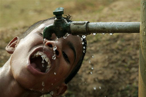 A young Indian boy drinks water from a public tap in Agartala, India, Wednesday, March 21, 2012. As the world gears up to celebrate World Water Day on March 22, the UN estimates that more than one in six people worldwide do not have access to 20-50 liters &#40;5-13 gallons&#41; of safe freshwater a day to ensure their basic needs for drinking, cooking and cleaning. &#40;AP Photo&#47;Sushanta Das&#41; <span class=meta>(AP Photo&#47; Sushanta Das)</span>