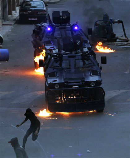 Bahraini anti-government protesters throw Molotov cocktails and rocks at armored personnel carriers Wednesday, March 21, 2012, in Sanabis, Bahrain, on the edge of the capital of Manama. Clashes erupted after  local residents claimed a teenager was attacked by police and according to information available on the internet, the Bahrain Interior Ministry is investigating the alleged incident.&#40;AP Photo&#47;Hasan Jamali&#41; <span class=meta>(AP Photo&#47; Hasan Jamali)</span>
