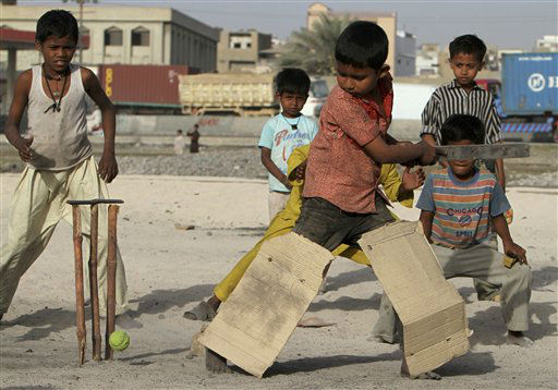 Young Bangladeshi refugee boys are all togged up to play cricket, on a clear piece of land near to their homes in a slum area of Karachi, Pakistan, on Thursday, March 22, 2012.&#40;AP Photo&#41; <span class=meta>(AP Photo&#47; Anonymous)</span>