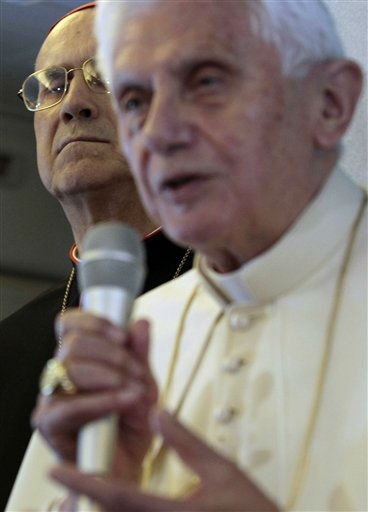 "<div class=""meta ""><span class=""caption-text "">Vatican Secretary of State Tarcisio Bertone, left, looks on as Pope Benedict XVI talks to journalists during a press conference aboard the airplane traveling to Silao, Mexico, Friday, March 23, 2012. Benedict's weeklong trip to Mexico and Cuba is his first to both countries. (AP Photo/Gregorio Borgia) (AP Photo/ Gregorio Borgia)</span></div>"