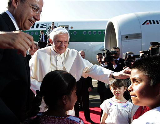 Mexico&#39;s President Felipe Calderon, left,  looks on as Pope Benedict XVI is greeted by children at the airport in Silao, Mexico, Friday March 23, 2012. Benedict&#39;s weeklong trip to Mexico and Cuba is his first to both countries.  &#40;AP Photo&#47;Gregorio Borgia&#41; <span class=meta>(AP Photo&#47; Gregorio Borgia)</span>