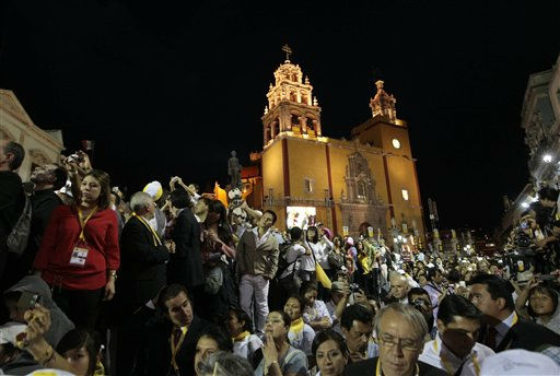 "<div class=""meta ""><span class=""caption-text "">Faithful listen to Pope Benedict XVI's message in the Plaza de la Paz or Peace Plaza in Guanajuato, Mexico, Saturday March 24, 2012.  The pope reserved his only public remarks Saturday for a gathering of about 4,000 children and their parents massed in the Plaza de la Paz or Peace Plaza. (AP Photo/Gregorio Borgia) (AP Photo/ Gregorio Borgia)</span></div>"