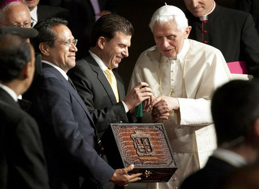 Pope Benedict XVI receives the symbolic key of the city from Leon Mayor Ricardo Sheffield, center, and Guanajuato Gov. Juan Manuel Oliva, left, in Leon, Mexico, Saturday March 24, 2012. Benedict arrived in Mexico Friday afternoon, a decade after the late Pope John Paul II&#39;s last visit. The pontiff&#39;s weeklong trip to Mexico and then to Cuba on Monday is his first to both countries. &#40;AP Photo&#47;Eduardo Verdugo&#41; <span class=meta>(AP Photo&#47; Eduardo Verdugo)</span>