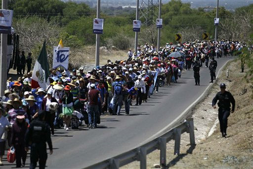 "<div class=""meta ""><span class=""caption-text "">Pilgrims walk along a road toward the site where Pope Benedict XVI will give a Sunday Mass in Bicentennial Park near Silao, Mexico, Saturday March 24, 2012.  Benedict arrived in Mexico Friday afternoon, a decade after the late Pope John Paul II's last visit. The pontiff's weeklong trip to Mexico and then to Cuba on Monday is his first to both countries. (AP Photo/Dario Lopez-Mills) (AP Photo/ Dario Lopez-Mills)</span></div>"