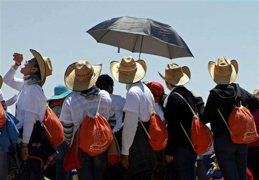 "<div class=""meta ""><span class=""caption-text "">ALTERNATIVE CROP OF MXDL109 .- Pilgrims take a break as they walk toward the site where Pope Benedict XVI will give a Sunday Mass in Bicentennial Park near Silao, Mexico, Saturday March 24, 2012.  Benedict arrived in Mexico Friday afternoon, a decade after the late Pope John Paul II's last visit. The pontiff's weeklong trip to Mexico and then to Cuba on Monday is his first to both countries. (AP Photo/Dario Lopez-Mills) (AP Photo/ Dario Lopez-Mills)</span></div>"