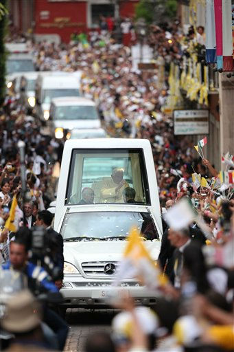 Pope Benedict XVI waves to faithful from his popemobile as he makes his way to Plaza de la Paz or Peace Plaza in Guanajuato, Mexico, Saturday, March 24, 2012. At the entrance to Guanajuato, Benedict received the keys to the city. The pope reserved his only public remarks Saturday for a gathering of about 4,000 children and their parents massed in the plaza. &#40;AP Photo&#47;Alexandre Meneghini&#41; <span class=meta>(AP Photo&#47; Alexandre Meneghini)</span>
