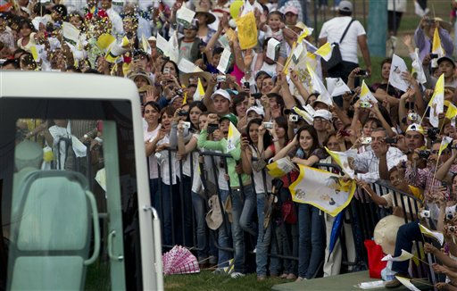 "<div class=""meta image-caption""><div class=""origin-logo origin-image ""><span></span></div><span class=""caption-text"">Faithful wave to Pope Benedict XVI as he passes by in his popemobile on his way to the Plaza de la Paz or Peace Plaza, in Guanajuato, Mexico, Saturday March 24, 2012. Benedict arrived in Mexico Friday afternoon, a decade after the late Pope John Paul II's last visit. The pontiff's weeklong trip to Mexico and then to Cuba on Monday is his first to both countries. (AP Photo/Eduardo Verdugo) (AP Photo/ Eduardo Verdugo)</span></div>"