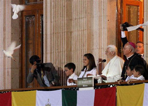 Pope Benedict XVI  watches as white doves are released by children after the Pope&#39;s speech in  in Guanajuato, Mexico, Saturday, March 24, 2012. At the entrance to Guanajuato, Benedict received the keys to the city. The pope reserved his only public remarks Saturday for a gathering of about 4,000 children and their parents massed in the plaza. &#40;AP Photo&#47;Alexandre Meneghini&#41; <span class=meta>(AP Photo&#47; Alexandre Meneghini)</span>
