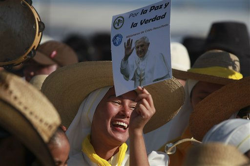 Pilgrims cheer and sing as they wait at the site where Pope Benedict XVI will give a Mass in Bicentennial Park near Silao, Mexico, Sunday March 25, 2012. &#40;AP Photo&#47;Dario Lopez-Mills&#41; <span class=meta>(AP Photo&#47; Dario Lopez-Mills)</span>