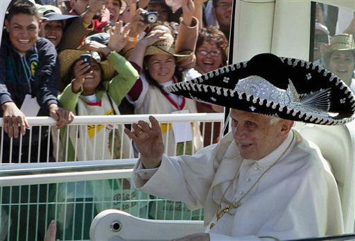 ALTERNATIVE CROP OF MXDL110 - Pope Benedict XVI waves from the popemobile wearing a Mexican sombrero as he arrives to give a Mass in Bicentennial Park near Silao, Mexico, Sunday March 25, 2012. &#40;AP Photo&#47;Eduardo Verdugo&#41; <span class=meta>(AP Photo&#47; Eduardo Verdugo)</span>