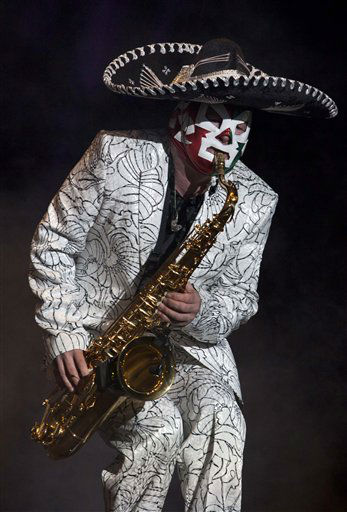 Wearing a Mexican sombrero and a Mexican wrestling mask, Lee Jay Thompson of Madness performs during the Vive Latino Festival in Mexico City, Sunday, March 25, 2012. &#40;AP Photo&#47;Christian Palma&#41; <span class=meta>(AP Photo&#47; Christian Palma)</span>