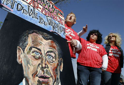 From left, Bette Grey from Berwick, Pa., left, Christine Golomb from Mifflinville, Pa., and Eileen Suraci from Bloomsburg, Pa., supporters for the health care reform law signed by President Barack Obama, carry a painting of House Speaker John Boehner as they rally in front of the Supreme Court in Washington, Monday, March 26, 2012, as the court begins three days of arguments on health care. &#40;AP Photo&#47;Charles Dharapak&#41; <span class=meta>(AP Photo&#47; Charles Dharapak)</span>
