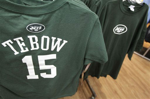 New York Jets football jerseys with the name and number of their new quarterback Tim Tebow hang on display at a Modell&#39;s store, Monday, March 26, 2012, in New York. At his introductory news conference Monday, the New York Jets backup quarterback, acquired from Denver last Wednesday, says he&#39;s grateful and excited to be with the team. &#40;AP Photo&#47;Mary Altaffer&#41; <span class=meta>(AP Photo&#47; Mary Altaffer)</span>