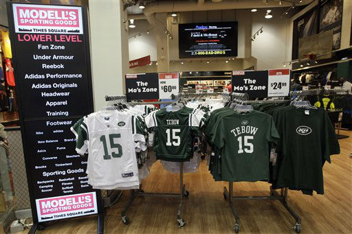 New York Jets football jerseys and shirts with the name and number of their new quarterback Tim Tebow hang on display at a Modell&#39;s store, Monday, March 26, 2012, in New York. At his introductory news conference Monday, the New York Jets backup quarterback, acquired from Denver last Wednesday, says he&#39;s grateful and excited to be with the team. &#40;AP Photo&#47;Mary Altaffer&#41; <span class=meta>(AP Photo&#47; Mary Altaffer)</span>