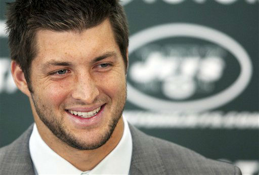 Tim Tebow holds his first news conference with the New York Jets, Monday, March 26, 2012, in Florham Park, N.J. Tebow, who led the Denver Broncos to the playoffs last year, was acquired in a trade Wednesday with Denver and will serve as the backup quarterback to Mark Sanchez. &#40;AP Photo&#47;Mark Lennihan&#41; <span class=meta>(AP Photo&#47; Mark Lennihan)</span>