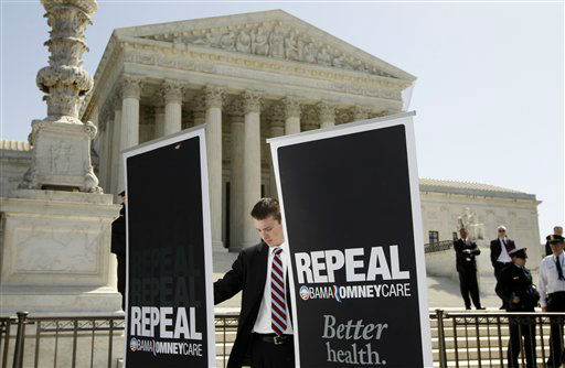 "<div class=""meta ""><span class=""caption-text "">An campaign aide for Republican presidential candidate, former Pennsylvania Sen. Rick Santorum, sets up signs before Santorum spoke in front of the Supreme Court in Washington, Monday, March 26, 2012, as the court began three days of arguments on the health care law signed by President Barack Obama. (AP Photo/Charles Dharapak) (AP Photo/ Charles Dharapak)</span></div>"