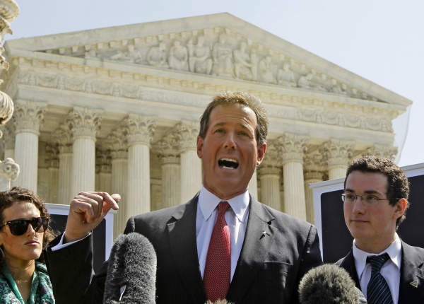 Republican presidential candidate, former Pennsylvania Sen. Rick Santorum, accompanied by his daughter Elizabeth Santorum and son Daniel Santorum, speaks in front of the Supreme Court  in Washington, Monday, March 26, 2012, as the court began three days of arguments on the health care law signed by President Barack Obama. &#40;AP Photo&#47;Charles Dharapak&#41; <span class=meta>(AP Photo&#47; Charles Dharapak)</span>
