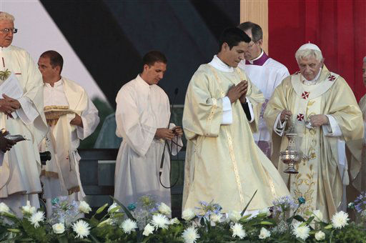 "<div class=""meta image-caption""><div class=""origin-logo origin-image ""><span></span></div><span class=""caption-text"">Pope Benedict XVI, right, celebrates a Mass at Revolution Square in Santiago de Cuba, Cuba, Monday, March 26, 2012. Pope Benedict XVI is in Cuba for a three-day visit. (AP Photo/Esteban Felix) (AP Photo/ Esteban Felix)</span></div>"