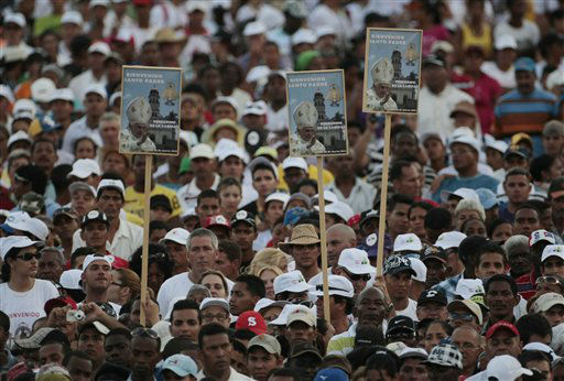 Faithful hold posters welcoming Pope Benedict XVI to Cuba as they gather at Revolution Square waiting for the arrival of the Pope to celebrate a Mass in Santiago de Cuba, Cuba, Monday, March 26, 2012. &#40;AP Photo&#47;Gregorio Borgia&#41; <span class=meta>(AP Photo&#47; Gregorio Borgia)</span>