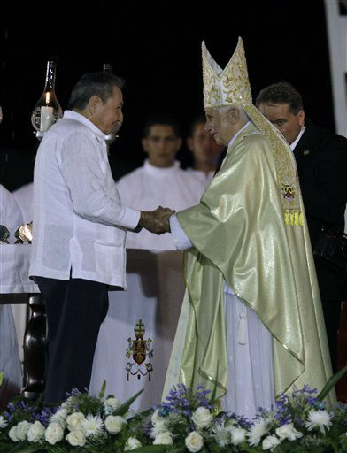 Cuban President Raul Castro greets Pope Benedict XVI after a Mass in Revolution Square in Santiago de Cuba, Cuba, Monday, March, 26, 2012.&#40;AP Photo&#47;Javier Galeano&#41; <span class=meta>(AP Photo&#47; Ramon Espinosa)</span>