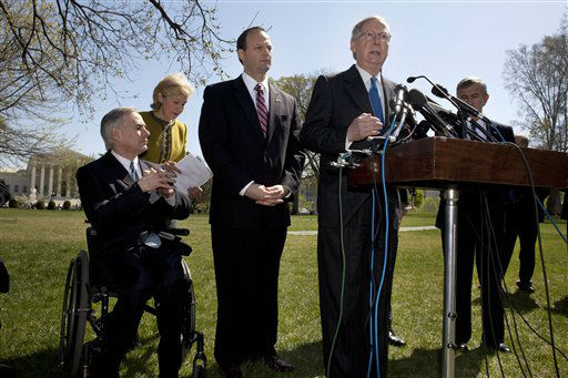 "<div class=""meta ""><span class=""caption-text "">Senate Minority Leader Mitch McConnell of Ky.,  at podium, speaks during a health care news conference on Capitol Hill in Washington, Tuesday, March 27, 2012, as the Supreme Court, rear, continued hearings  on President Obama's health care legislation. From left are, Texas Attorney General Greg Abbott, Sen. Kay Bailey Hutchison, R-Texas, South Carolina Attorney General Alan Wilson, McConnell, and Sen. Mike Johanns, R-Neb.  (AP Photo/Jacquelyn Martin) (AP Photo/ Jacquelyn Martin)</span></div>"