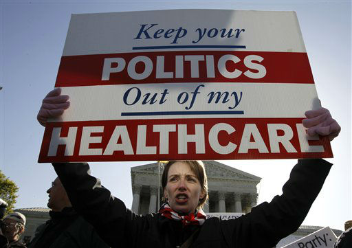 "<div class=""meta ""><span class=""caption-text "">Amy Brighton from Medina, Ohio, who opposes health care reform, rallies in front of the Supreme Court  in Washington, Tuesday, March 27, 2012, as the court continues arguments on the health care law signed by President Barack Obama. (AP Photo/Charles Dharapak) (AP Photo/ Charles Dharapak)</span></div>"