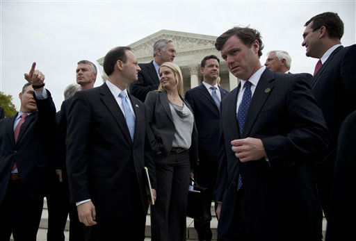 Florida Attorney General Pam Bondi, center, is surrounded by various attorneys general outside the Supreme Court in Washington, Wednesday, March 28, 2012, after court concludes three days of hearing arguments on the constitutionality of President Barack Obama&#39;s health care overhaul, the Patient Protection and Affordable Care Act. &#40;AP Photo&#47;Carolyn Kaster&#41; <span class=meta>(AP Photo&#47; Carolyn Kaster)</span>