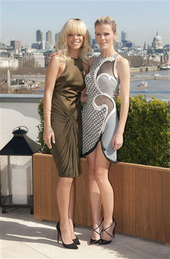 Rihanna and Brooklyn Decker, right, pose for photographers in front of a London skyline atop a central London hotel during a photocall for their film &#39;Battleship&#39;, Wednesday, March 28, 2012. &#40;AP Photo&#47;Joel Ryan&#41; <span class=meta>(AP Photo&#47; Joel Ryan)</span>