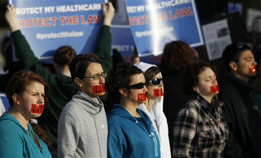 Anti-abortion demonstrators stand in front of the Supreme Court in Washington, Wednesday, March 28, 2012, on the final day of arguments regarding the health care law signed by President Barack Obama. &#40;AP Photo&#47;Charles Dharapak&#41; <span class=meta>(AP Photo&#47; Charles Dharapak)</span>