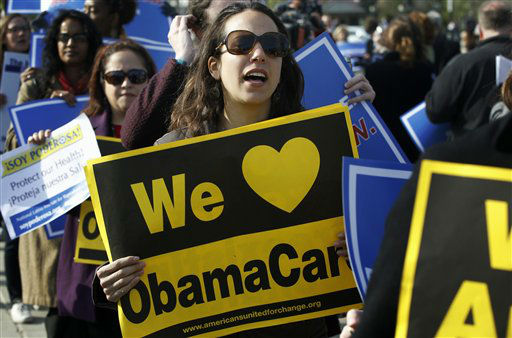 Supporters of health care reform stand in front of the Supreme Court in Washington, Wednesday, March 28, 2012, on the final day of arguments regarding the health care law signed by President Barack Obama. &#40;AP Photo&#47;Charles Dharapak&#41; <span class=meta>(AP Photo&#47; Charles Dharapak)</span>