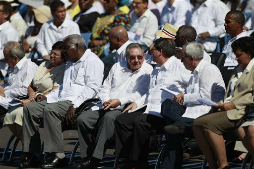 Cuba&#39;s President Raul Castro, center, attends a Mass celebrated by  Pope Benedict XVI Mass at Revolution Square in Havana, Cuba, Wednesday, March. 28, 2012.  Pope Benedict XVI wraps up his visit to Cuba on Wednesday with an open-air Mass in the shrine of the Cuban revolution&#40;AP Photo&#47;Ramon Espinosa&#41; <span class=meta>(AP Photo&#47; Ramon Espinosa)</span>