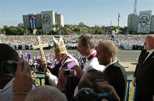 Pope Benedict XVI waves to faithful as arrives to lead a Mass at Revolution Square in Havana, Cuba, Wednesday March 28, 2012.  Pope Benedict XVI wraps up his visit to Cuba on Wednesday with an open-air Mass in the shrine of the Cuban revolution.&#40;AP Photo&#47;Gregorio Borgia&#41; <span class=meta>(AP Photo&#47; Gregorio Borgia)</span>