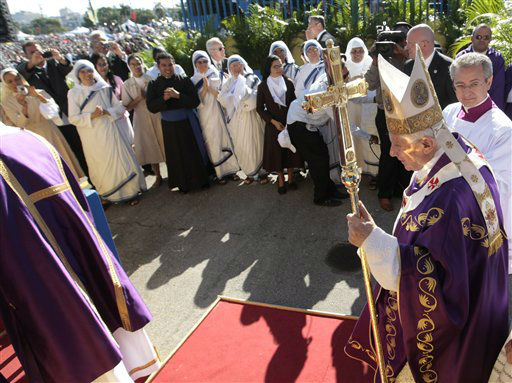 "<div class=""meta image-caption""><div class=""origin-logo origin-image ""><span></span></div><span class=""caption-text"">Pope Benedict XVI walks with the pastoral staff prior to the start of a mass in Havana's Revolution square, Wednesday, March 28, 2012.  Pope Benedict XVI wraps up his visit to Cuba on Wednesday with an open-air Mass in the shrine of the Cuban revolution.(AP Photo/Gregorio Borgia) (AP Photo/ Gregorio Borgia)</span></div>"