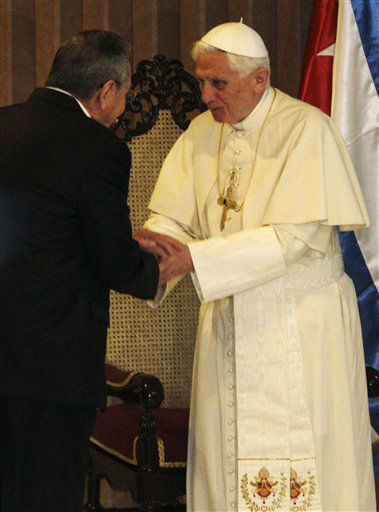 Cuba&#39;s President Raul Castro, left, says goodbye to Pope Benedict XVI at the end of the pope&#39;s visit, at the airport in Havana, Cuba, Wednesday March 28, 2012. &#40;AP Photo&#47;Sven Creutzmann, Pool&#41; <span class=meta>(AP Photo&#47; Sven Creutzmann)</span>