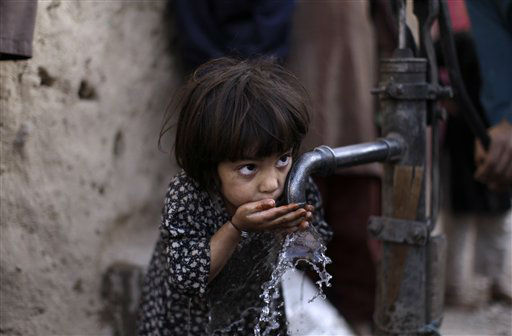 Afghan refugee Ayshah Faqir, 5, drinks water from a hand pump in a slum area on the outskirts of Islamabad, Pakistan, Wednesday, March 28, 2012. &#40;AP Photo&#47;Muhammed Muheisen&#41; <span class=meta>(AP Photo&#47; Muhammed Muheisen)</span>