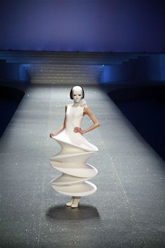 A model wears a creation from Pierre Cardin at his Palais Lumi?re - the City of Light fashion show at the Water Cube in Beijing, China, Sunday, April 1, 2012. &#40;AP Photo&#47;Ng Han Guan&#41; <span class=meta>(AP Photo&#47; Ng Han Guan)</span>