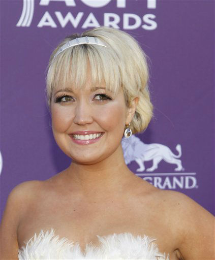 Meghan Linsey, of musical group Steel Magnolia, arrives at the 47th Annual Academy of Country Music Awards on Sunday, April 1, 2012 in Las Vegas. &#40;AP Photo&#47;Isaac Brekken&#41; <span class=meta>(AP Photo&#47; Isaac Brekken)</span>