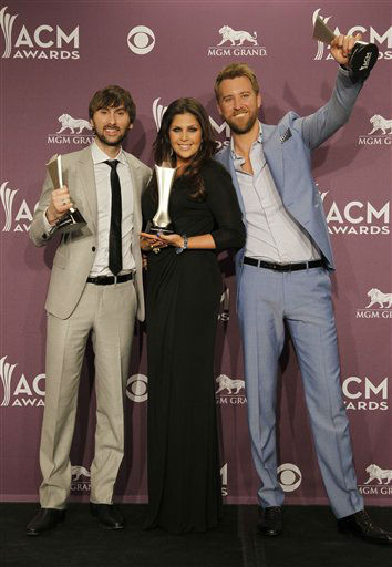 From left, Dave Haywood, Hillary Scott and Charles Kelley, of musical group Lady Antebellum, pose backstage with the award for vocal group of the year at the 47th Annual Academy of Country Music Awards on Sunday, April 1, 2012 in Las Vegas. &#40;AP Photo&#47;Isaac Brekken&#41; <span class=meta>(AP Photo&#47; Isaac Brekken)</span>