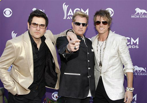 From left, Jay Demarcus, Gary LeVox and Joe Don Rooney, of musical group Rascal Flatts, arrive at the 47th Annual Academy of Country Music Awards on Sunday, April 1, 2012 in Las Vegas. &#40;AP Photo&#47;Isaac Brekken&#41; <span class=meta>(AP Photo&#47; Isaac Brekken)</span>