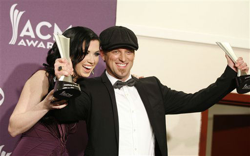 Shawna Thompson, left, and Keifer Thompson, of musical group Thompson Square, pose backstage with their awards for vocal duo of the year at the 47th Annual Academy of Country Music Awards on Sunday, April 1, 2012 in Las Vegas. &#40;AP Photo&#47;Isaac Brekken&#41; <span class=meta>(AP Photo&#47; Isaac Brekken)</span>