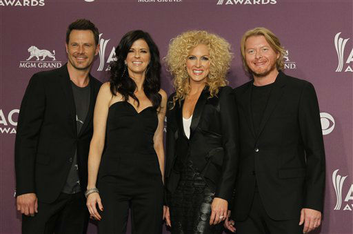 From left, Jimi Westbrook, Karen Fairchild, Kimberly Schlapman and Phillip Sweet of musical group Little Big town pose backstage at the 47th Annual Academy of Country Music Awards on Sunday, April 1, 2012 in Las Vegas. &#40;AP Photo&#47;Isaac Brekken&#41; <span class=meta>(AP Photo&#47; Isaac Brekken)</span>