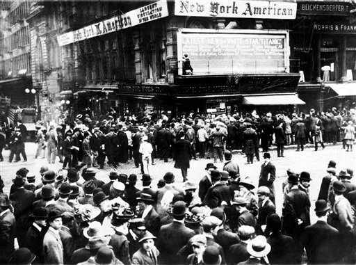 ADVANCE FOR USE SUNDAY, APRIL 8, 2012 AND THEREAFTER - FILE - In this April 1912 file photo, crowds gather around the bulletin board of the New York American newspaper in New York, where the names of people rescued from the sinking Titanic are displayed. It was a news story that would change the news. From the moment that a brief Associated Press dispatch relayed the wireless distress call _ &#34;Titanic ... reported having struck an iceberg. The steamer said that immediate assistance was required&#34; _ reporters and editors scrambled. In ways that seem familiar today, they adapted a dawning newsgathering technology and organized saturation coverage and managed to cover what one authority calls &#34;the first really, truly international news event where anyone anywhere in the world could pick up a newspaper and read about it.&#34; &#40;AP Photo&#41; <span class=meta>(AP Photo&#47; Anonymous)</span>